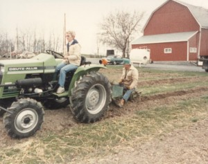 Dick and Cindy Peterson plowing to plant more vines in 1989.